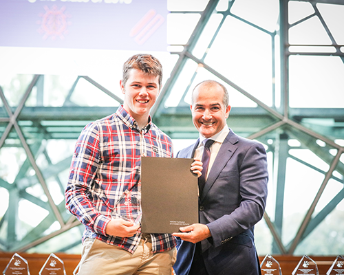 Lachlan receiving award from Minister