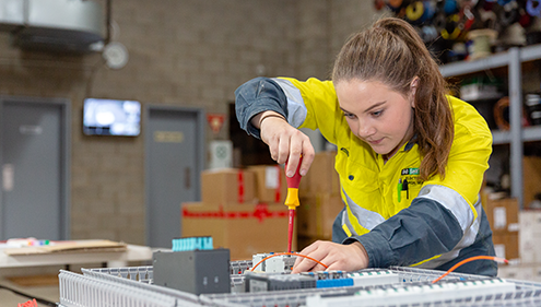 A female VET Electrical Industry student working
